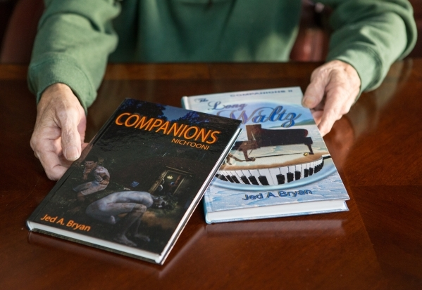 Mormon author Jed Bryan displays copies of his books in his home office in Henderson on Thursday, Nov. 19, 2015. Bryan also designed the covers. Donavon Lockett/Las Vegas Review-Journal