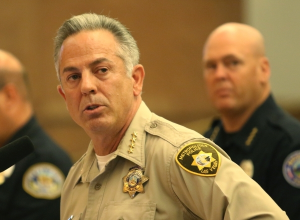 Clark County Sheriff Joseph Lombardo, front, speaks as Mesquite Police Chief Troy Tanner looks on during a public hearing for More Cops sales tax at a County Commission meeting at the commission c ...