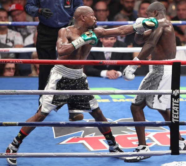 Floyd Mayweather, left, connects a punch against Andre Berto in their WBC/WBA Welterweight Title bout at MGM Grand Garden Arena in Las Vegas Saturday, Sept. 12, 2015. ERIK VERDUZCO/LAS VEGAS REVIE ...