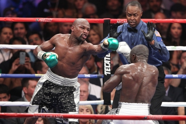 Floyd Mayweather, left, throws a punch against Andre Berto in their WBC/WBA Welterweight Title bout at MGM Grand Garden Arena in Las Vegas Saturday, Sept. 12, 2015. ERIK VERDUZCO/LAS VEGAS REVIEW- ...