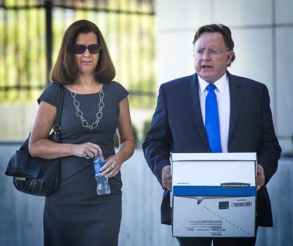 Ex-dancer Stephanie Markham, left, walks with  her attorney Robert Langford  arrives for court at Lloyd George U.S. Courthouse, 333 Las Vegas Boulevard, on Monday, Sept. 28,2015. (Jeff Scheid/Las  ...