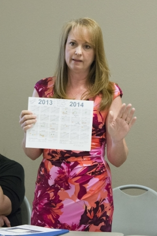 North Las Vegas Judge Catherine Ramsay holds up a 2013/2014 calendar with annotations explaining her whereabouts as a defense to the recall initiative targeting her during the North Valley Leaders ...