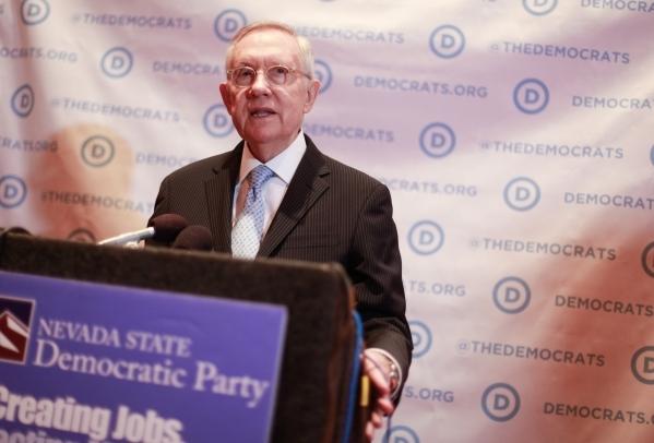 U.S. Sen. Harry Reid, D-Nev., speaks with news media ahead of the CNN Democratic presidential debate at the Wynn hotel-casino in Las Vegas on Tuesday, Oct. 13, 2015. Chase Stevens/Las Vegas Review ...