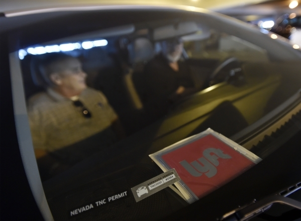 Lyft driver Dennis Alderman departs with his passengers, Shelley and Michael Gross, after picking them up at McCarran International Airport on Monday, Oct. 26, 2015.  The couple, from Houston, Tex ...