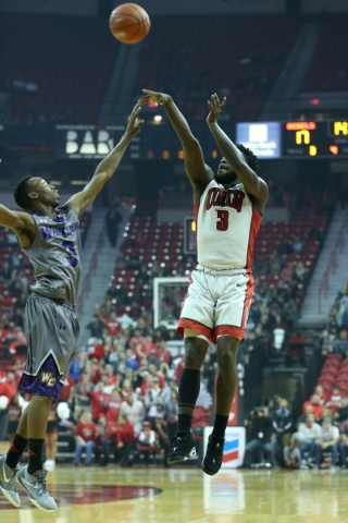 UNLV's Jordan Cornish (3) takes a shot over Whittier's Eric Jennings in their men's exhibition game at the Thomas and Mack Center in Las Vegas Friday, Nov. 6, 2015. UNLV won 94-5 ...
