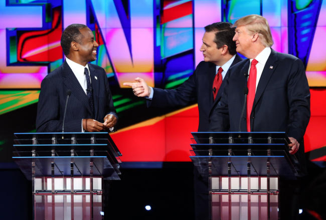 Ben Carson, from left, Ted Cruz and Donald Trump talk during a break in the CNN Republican presidential debate at the Venetian hotel-casino in Las Vegas on Tuesday, Dec. 15, 2015. Chase Stevens/La ...