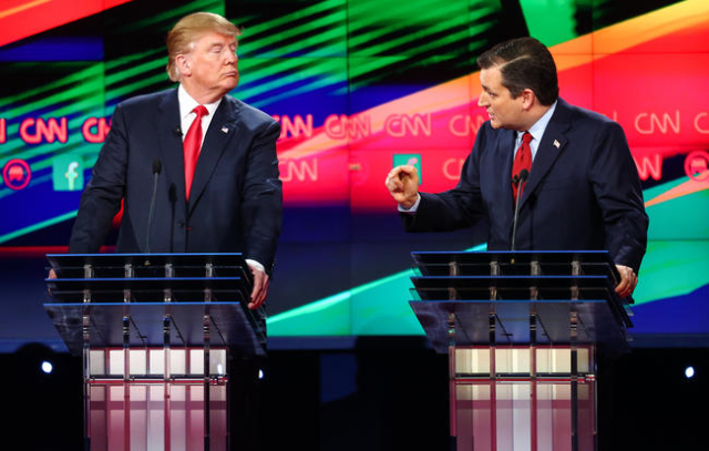 Ted Cruz, right, speaks as Donald Trump looks on during the CNN Republican presidential debate at the Venetian hotel-casino in Las Vegas on Tuesday, Dec. 15, 2015. Chase Stevens/Las Vegas Review-J ...