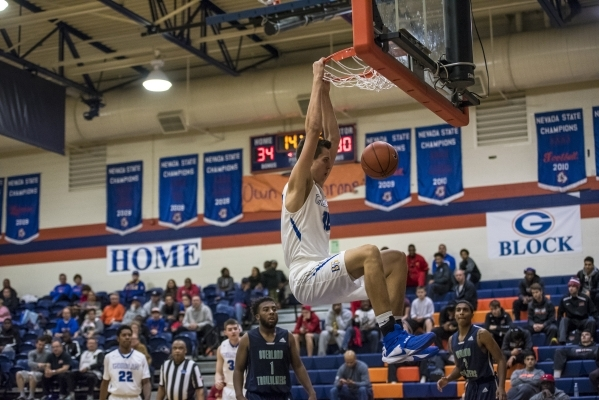 Bishop Gorman center Zach Collins (12) dunks the ball against Overland, Colo., during the championship game at Bishop Gorman High School in Las Vegas on Friday, Dec. 19, 2015. Joshua Dahl/Las Vega ...