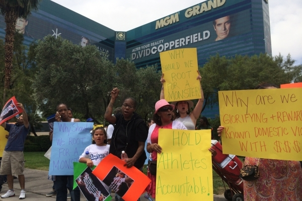 Picketers gather May 1, 2015, in front of the MGM hotel-casino to protest the domestic violence history of boxer Floyd Mayweather ahead of his fight with Manny Pacquiao. The event was organized by ...