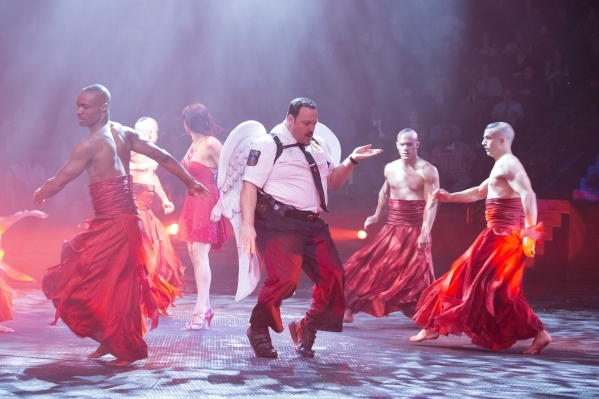 "Paul Blart (Kevin James) on stage with the ""Le Reve"" performers at Wynn Las Vegas in Columbia Pictures' ""Paul Blart: Mall Cop 2."""