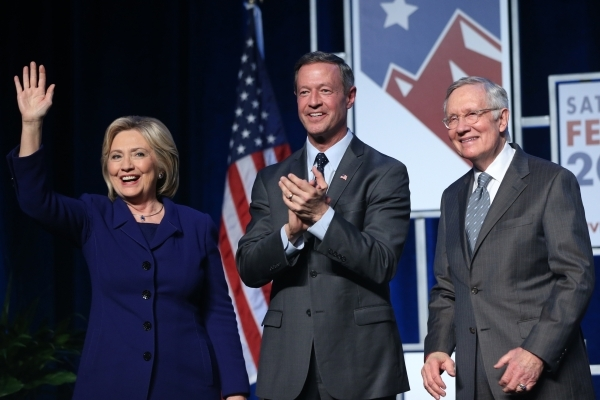 Democratic presidential candidates from left, Hillary Clinton, Martin O'Malley and U.S. Sen. Harry Reid, pose on stage during the Battle Born/Battleground First in the West Caucus Dinner at  ...
