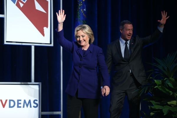 Democratic presidential candidates Hillary Clinton, left, and Martin O'Malley take the stage during the Battle Born/Battleground First in the West Caucus Dinner at the MGM Grand Conference C ...