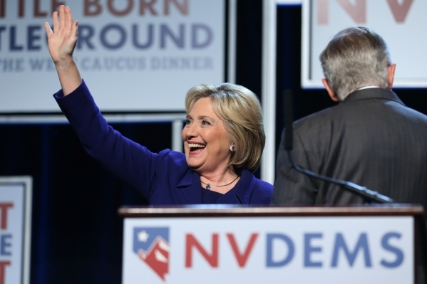 Democratic presidential candidate Hillary Clinton waves at supporters while on stage during the Battle Born/Battleground First in the West Caucus Dinner at the MGM Grand Conference Center on Wedne ...