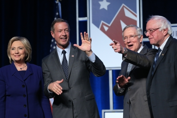 Democratic presidential candidates from left, Hillary Clinton, Martin O'Malley, U.S. Sen. Harry Reid, and Bernie Sanders pose on stage during the Battle Born/Battleground First in the West C ...