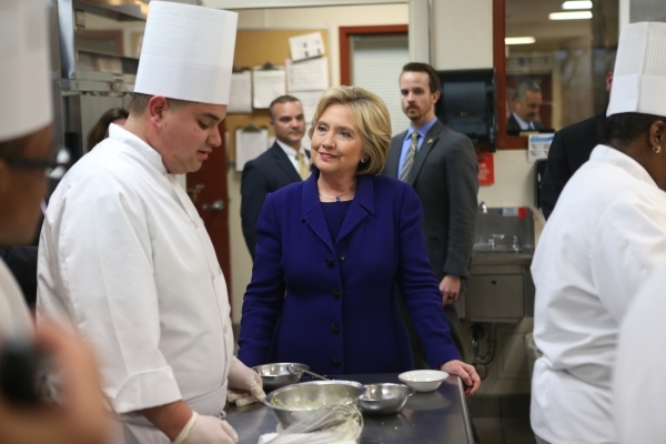 Democratic presidential candidate Hillary Clinton speaks with student Gary Brian Gonzalez during a tour of the Culinary Academy of Las Vegas Wednesday, Jan. 6, 2016, in North Las Vegas. Erik Verdu ...