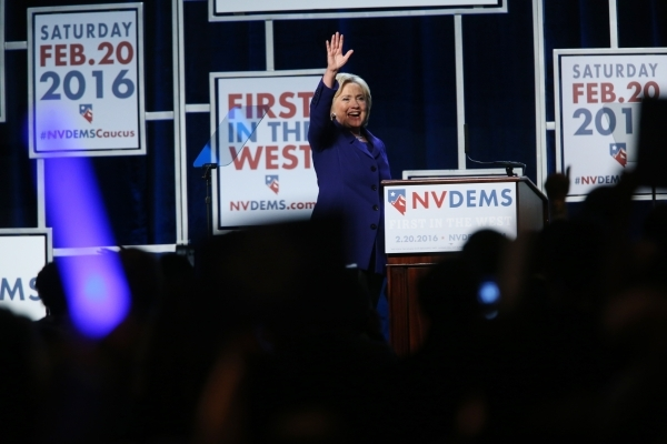 Democratic presidential candidate Hillary Clinton waves at the crowd after delivering her speech during the Battle Born/Battleground First in the West Caucus Dinner at the MGM Grand Conference Cen ...