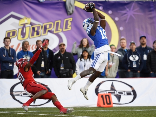 BYU wide receiver Devon Blackmon pulls down a pass after beating Utah defensive back Marcus Williams during the Royal Purple Las Vegas Bowl on Dec. 19, 2015, at Sam Boyd Stadium. Utah won 35-28. ( ...