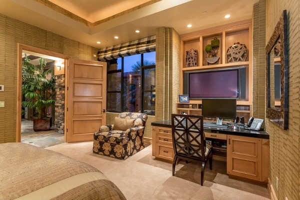 The home's second master bedroom has a desk and sitting area. COURTESY