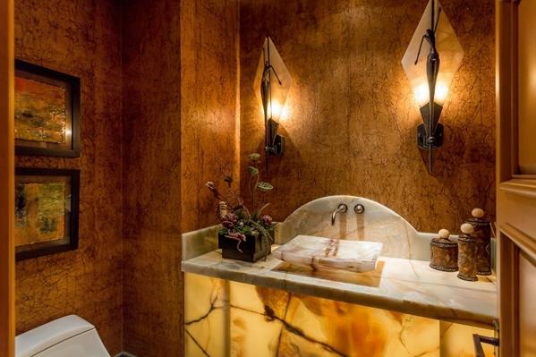 A powder room. The home has eight  baths. COURTESY