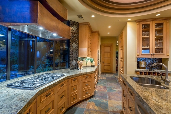The kitchen has a lengthy space that holds ovens and a stove-top range. COURTESY
