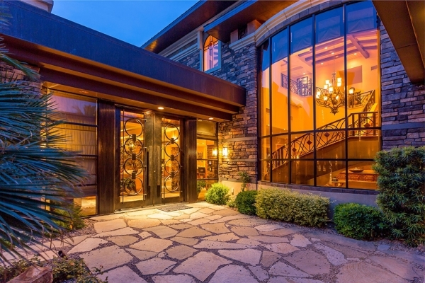 The home has six bedrooms, eight baths and a casita. COURTESY
