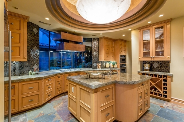 The kitchen has a handy wine bottle storage nook and extensive cupboards. COURTESY