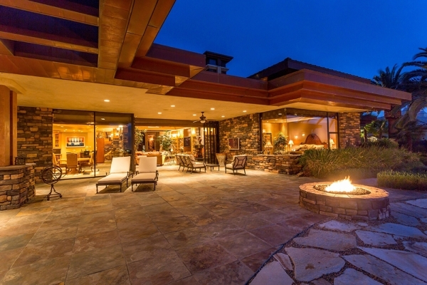 The Seven Hills home  has a patio with a fire feature. COURTESY