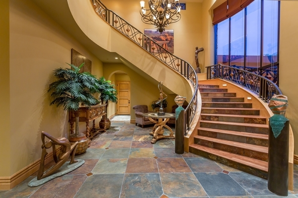 The home's staircase is ornate. COURTESY