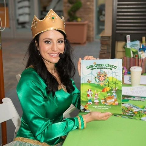 Angela Vincent holds a copy of her book, þÄúSave Queen Green! Mother Nature's Eco-Rhymes,þÄù in this undated photo as she takes on a Mother Nature-type persona. Vincent and ...