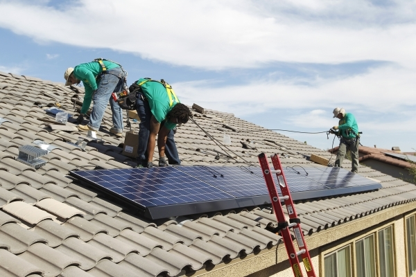 From left, Lyle Bradford, crew leader Greg Kates and Guillermo Aviles install solar panels for Solar City on a North Las Vegas home Thursday, Oct. 30, 2014. (Sam Morris/Las Vegas Review-Journal)
