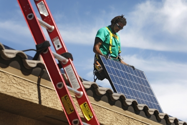 Solar City installation crew leader Greg Kates installs solar panels on a North Las Vegas home Thursday, Oct. 30, 2014. (Sam Morris/Las Vegas Review-Journal)