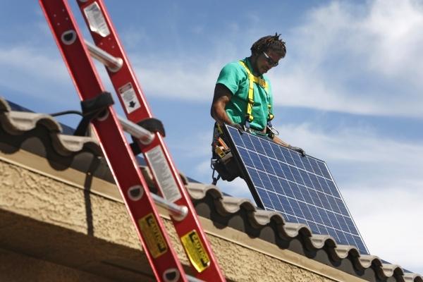 Solar City installation crew leader Greg Kates installs solar panels on a North Las Vegas home Thursday, Oct. 30, 2014. (Sam Morris/Las Vegas Review-Journal)
