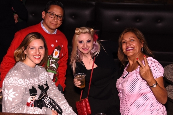 Araxie Grant, Carlos Mungaray, Tanya Davis and Corine Sabedra smile Dec. 1 during Dress for Success Southern Nevada's Ho Ho Horrible Holiday Sweater cocktail party fundraiser. Special to View