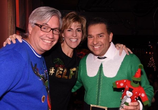 From left, Bart Patterson, Paula Lawrence and Gerard Ramalho smile Dec. 1 during Dress for Success Southern Nevada's Ho Ho Horrible Holiday Sweater cocktail party fundraiser. Special to View