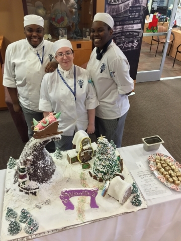 Winners Quanisha Scott, Keliann Kutasienski and Miya Williams smile Dec. 8 at Le Cordon Bleu College of Culinary Arts during its One Bite contest. Special to View