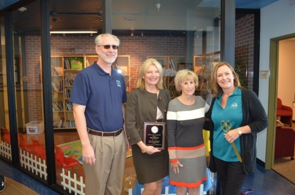 The Rev. Craig Michaelson, Heidi Kasama, Clark County Commissioner Susan Brager and Tonia Tate celebrate Faith Community Lutheran Church's preschool moving to 10405 Griffith Peak Drive with  ...