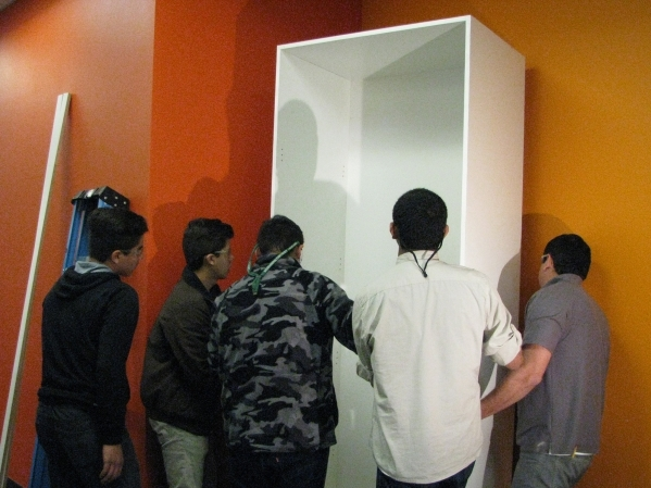 Teacher Fausto Vega of East Career and Technical Academy, 6705 Vegas Valley Drive had  his class create new cabinets for Three Square food bank. He and some of his students installed the cabinets  ...