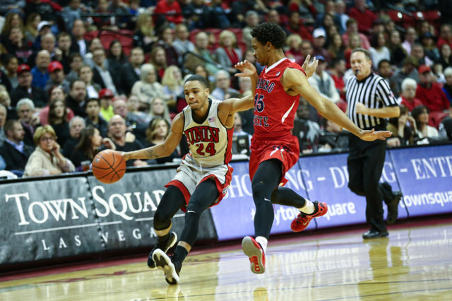 UNLV guard Jalen Poyser (24) drives against Fresno State guard Lionel Ellison III (15) during a basketball game at the Thomas & Mack Center in Las Vegas on Wednesday, Dec. 30, 2015. (Chase Ste ...