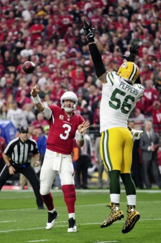 Dec 27, 2015; Glendale, AZ, USA; Arizona Cardinals quarterback Carson Palmer (3) throws as Green Bay Packers outside linebacker Julius Peppers (56) defends during the first half at University of P ...