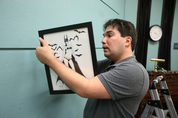 Artist Joshua Weinberg installs one of his drawings for an upcoming gallery show titled Pop Culture Pin Ups at the Green Valley Library on Wednesday, Jan. 30, 2015 in Henderson, Nev. Erik Verduzco ...