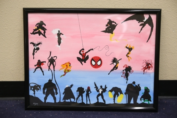 A Spiderman characters silhouette drawing by Joshua Weinberg is seen ready for installation for an upcoming gallery show titled Pop Culture Pin Ups at the Green Valley Library on Wednesday, Jan. 3 ...