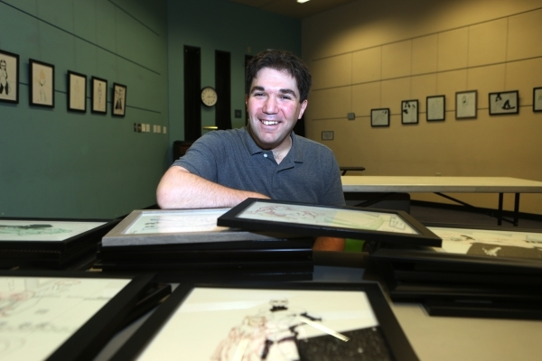 Artist Joshua Weinberg poses for a portrait at the Green Valley Library on Wednesday, Jan. 30, 2015 in Henderson, Nev. Weinberg will be exhibiting his work at the Green Valley Library in an upcomi ...