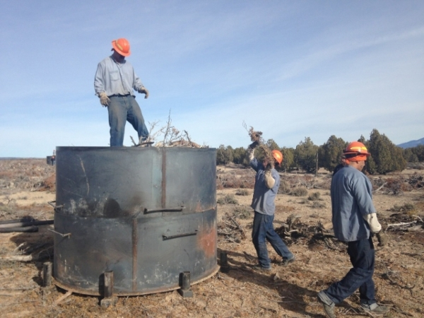 Crews with the Nevada Division of Forestry load a kiln as they prepare to make charcoal from pinion-juniper trees near Ely on Dec. 9, 2015. The process is an experiment on how to utilize forest pr ...
