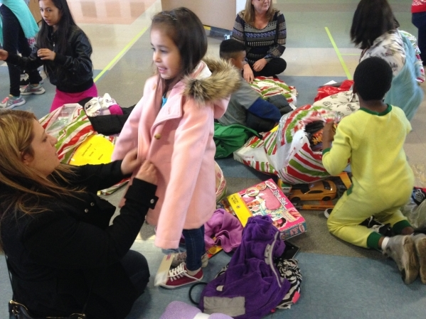 The Las Vegas Hospitality Association hosted its Fill a Bag with Cheer program Dec. 18, providing 300 children in need with bags of items. The organization's members were paired with 300 chi ...
