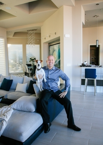 Sports agent Brian Fettner and his Jack Russell Terrier, Maverick, live in a $4 million custom home in Henderson's MacDonald Highlands. ELKE COTE/REAL ESTATE MILLIONS