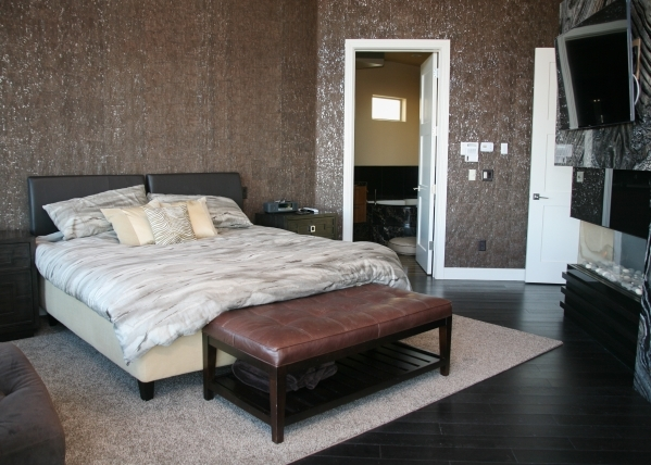 The bedrooms have an expensive, unusual wall covering that blends thin layer of cork with metallic leafing, creating dark and light on the wall. ELKE COTE/REAL ESTATE MILLIONS