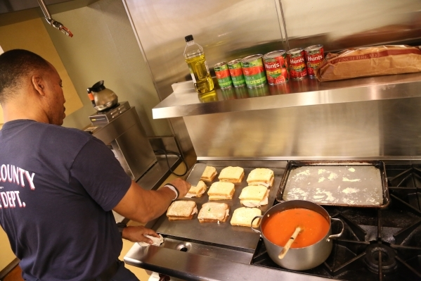 Capt. Michael Lee of the Clark County Fire Department station 28 prepares paninis for lunch for platoon #3 in Summerlin, Wednesday, Dec. 30, 2015 in Las Vegas. Rachel Aston/Las Vegas Review-Journa ...