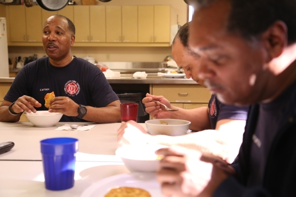 Capt. Michael Lee, from left, of the Clark County Fire Department station 28 talks over lunch with Firefighters Maceo Woolard and Sir Lindbergh Collymore of platoon #3 in Summerlin, Wednesday, Dec ...