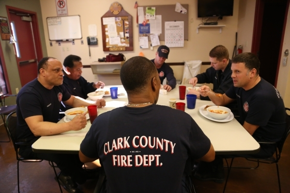 Capt. Michael Lee, center, of the Clark County Fire Department station 28 talks over lunch with Firefighters Maceo Woolard, from left, Sir Lindbergh Collymore, Engineer Kevin Lunkwitz, Firefighter ...
