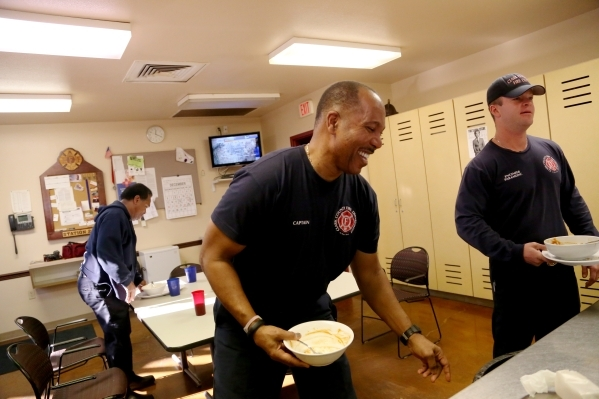Capt. Michael Lee, center, of the Clark County Fire Department station 28 laughs after lunch alongside Firefighter Sir Lindbergh Collymore, left, and Engineer Kevin Lunkwitz, right, of platoon #3  ...